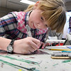 Kaylee Lantz works on a project during after school lessons at Creatice Arts Enid Tuesday January 17, 2017. (Billy Hefton / Enid News & Eagle)