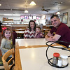 Ivan Dickey (right) sits with with his wife, Brittney, daughter Emma and son Tucker, sit inside Godfather's Pizza Wednesday January 11, 2017. Dickey has recently taken over ownership of the business. (Billy Hefton / Enid News & Eagle)
