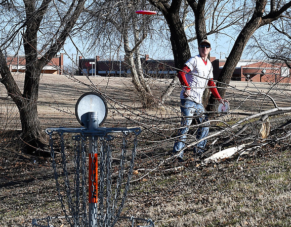 Matt Martin watches his disc as he plays a round at the NWOSU Enid disc golf course Friday January 27, 2017. (Billy Hefton / Enid News & Eagle)