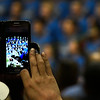 A member of the audience take video during the 2017 Region B Circle the State with Song Choral Festival Tuesday January 10, 2017 at the Convention Hall inside the Central National Bank Center. (Billy Hefton / Enid News & Eagle)