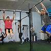 Men do pull-ups during in a class at CrossFit ReFuel January 17, 2017. (Billy Hefton / Enid News & Eagle)