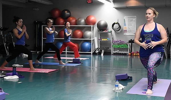 Meg Sandlin leads a yoga class at the Denny Price Family YMCA January 31, 2017. (Billy Hefton / Enid News & Eagle)