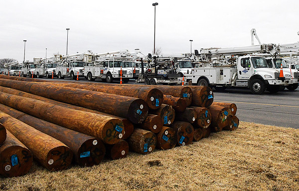 Repair trucks and utility poles are staged at the Oakwood Mall parking lot Friday January 13, 2017. (Billy Hefton / Enid News & Eagle)