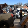 Representatives from Security National Bank unload boxes of school supplies Wednesday January 4, 2017 that are being donated to Taft Elementary as part of Project SNB. (Billy Hefton / Enid News & Eagle)