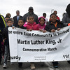 Young people carry a banner as they march through downtown Enid Saturday January 21, 2017 inviting everyone to join the commemorative march honoring Dr. Martin Luther King, Jr. (Billy Hefton / Enid News & Eagle)