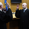 Judge Jason Seigars (right) takes the oath of office for Special District Judge from Judge Paul Woodward Tuesday January 3, 2016 at the Garfield County Courthouse. (Billy Hefton / Enid News & Eagle)