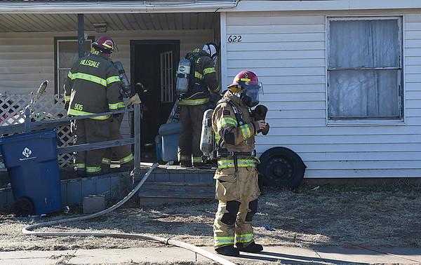 Firefighters prepare to enter the residence at 622 Garfield in Lahoma Thursday January 26, 2017. Units from Lahoma, Drummond and Hillsdale-Carrier fiore departments responed structure fire. (Billy Hefton / Enid News & Eagle)