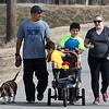 Patrick, Jamie, Jayden and Paxton Colclasure take advantage of the warm weather Monday January 2, 2017 to spend time together on the Enid Trail system. (Billy Hefton / Enid News & Eagle)