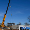 A crane moves material at the Prairie Flats Apartments construction site Wednesday January 3, 2018. (Billy Hefton / Enid News & Eagle)