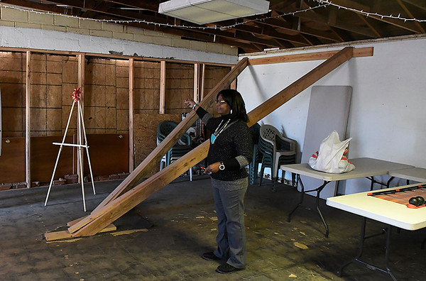 Barbara Finley gestures as she talks about the repairs needed at the Southern Heights Heritage Center and Museum after a car crashed into the building in September 2016. (Billy Hefton / Enid News & Eagle)