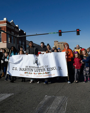 Young people carry a banner as they march through downtown Enid Saturday January 13, 2018  honoring Dr. Martin Luther King, Jr. (Billy Hefton / Enid News & Eagle)