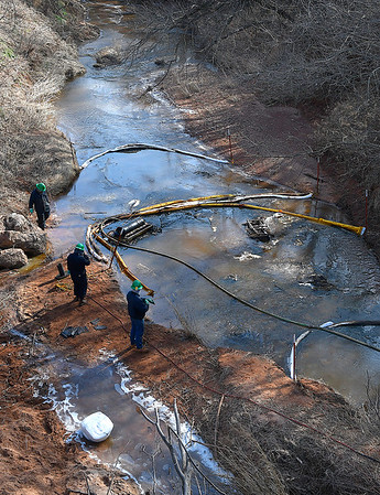 Members of a clean up crew work an oil spill in Black Bear Creek on South Knox Road between Rupe and Southgate in eastern Garfield county Thursday January 31, 2019. (Billy Hefton / Enid News & Eagle)