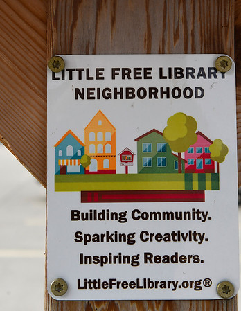 A sign at the Little Free Library at the Cleveland Street Trailhead on the Enid trail system Thursday January 17, 2019. The Little Free Library is Take a Book - Return a Book program. (Billy Hefton / Enid News & Eagle)
