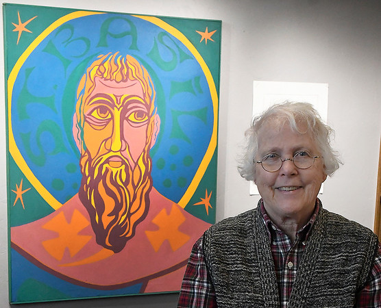 Margaret Moss stands with her painting of St. Basil at St. Matthews Episcopal Church Friday January 4, 2019. (Billy Hefton / Enid News & Eagle)