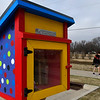 A man walks pass the Little Free Library at the Cleveland Street Trailhead on the Enid trail system Thursday January 17, 2019. The Little Free Library is Take a Book - Return a Book program. (Billy Hefton / Enid News & Eagle)