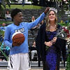 Enid High School's basketball homecoming king, Carlos Menefield tries to straighten the crown of queen Cayti Moeller Friday January 18, 2019 at the Central National Bank Center. (Billy Hefton / Enid News & Eagle)