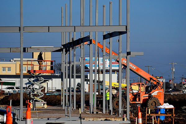 Construction workers put up steel on the Jiffy Trip being built on the corner of Garland and Garriott. (Billy Hefton / Enid News & Eagle)