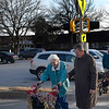 Enid mayor, Bill Shewey, walks with Lorna Daugherty across the new crosswalk in front of the Commons at Oakwood and La Mesa after a ribbon cutting ceremony Wednesday January 2, 2019. (Billy Hefton / Enid news & Eagle)