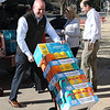 Cory Moore, Tiffany Dent and Scott Athey unload supplies at Adams Elementary Tuesday, January 7, 2020. (Billy Hefton / Enid News & Eagle)