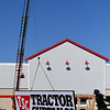 A crane unloads the sign for Tractor Supply Co. Tuesday. January 7, 2020. (Billy Hefton / Enid News & Eagle)
