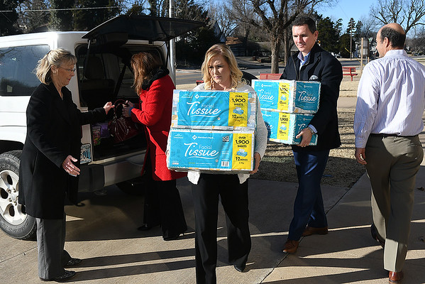 Becky Bules, April Danahy, Tiffany Dent, Jason Turnbow and Scott Athey unload supplies at Adams Elementary Tuesday, January 7, 2020. (Billy Hefton / Enid News & Eagle)