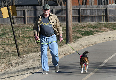 Jeff Taylor and Sarah take advantage of the weather Thursday to take a walk on the Enid Trail system. As of 3 p.m. Thursday the Mesonet at Breckinridge had recorded a high temperature of 69 degrees. (Billy Hefton / Enid News & Eagle)