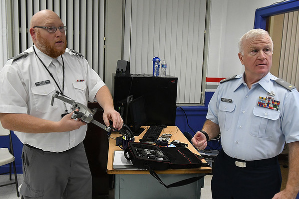 Civil Air Patrol member, Frank Hooper (left) and Civil Air Patrol 2nd Lt. Eric Holtzclaw talk about the use of drones in the civil air patrol during a meeting January 13, 2020 at Emerson Middle School. (Billy Hefton / Enid News & Eagle)