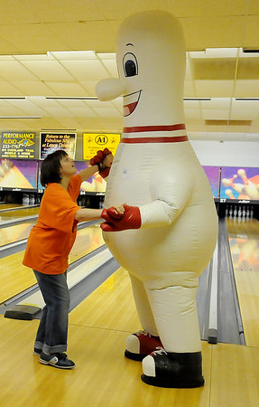 Maressa Arthurs dances with King Pin during the National Dance Day video taping at Oakwood Bowl Saturday, July 27, 2013. (Staff Photo by BONNIE VCULEK)