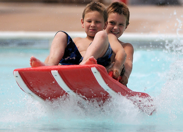 Waylon White (front), from Palestine, Tex., and Yancey Logsdon, from Brazoria, Tex., enjoy Splash Zone's Drop Zone Tuesday, July 2, 2013. Both young men are visiting their fathers who work in Enid. (Staff Photo by BONNIE VCULEK)