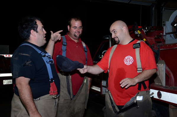 Deputy and firefighter Darryl Beebe, left, Lieutenant Bobby Kokojan, middle, and Captain Phillip Ott, right, joke around after responding to calls Thursday evening, July 4, at the Waukomis Fire Station. The Waukomis Department meets at the station every July 4 evening to respond to calls because fireworks cause multiple fires during the holiday. (Staff Photo by JESSICA SALMOND).