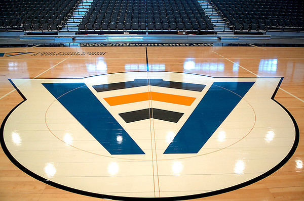 The Enid Event Center logo at center court of the new basketball floor Monday. The floor consist of 200 sections and weighs 44,000 pounds. (Staff Photo by BILLY HEFTON)
