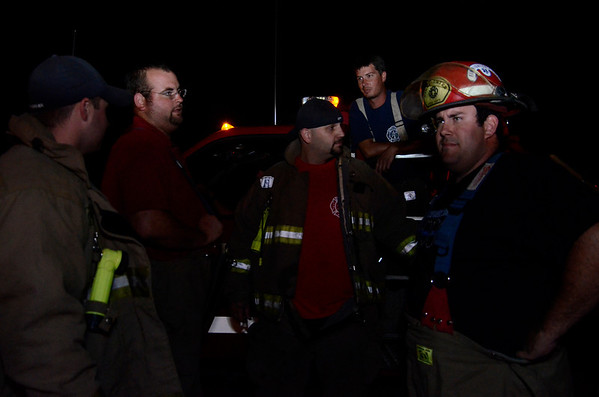 Members of the Waukomis Fire Department fill up truck tanks and wait for the next call Thursday, July 4, in Garfield County. (Staff Photo by JESSICA SALMOND)