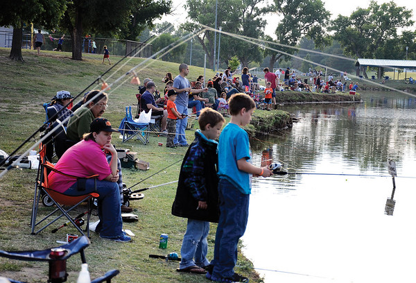 The banks were dotted with new and experienced fishers for the fishing derby July 4 at Meadowlake Park. Some participants arrived at 5 a.m. (Staff Photo by JESSICA SALMOND)
