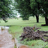 Debris from the Cimarron River remains in the yard of a resident near Loyal after heavy rains caused localized flooding in Kingfisher County early Friday, July 26, 2013. (Staff Photo by BONNIE VCULEK)