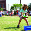 Skyler Jernigan, 9, races to squeeze out her sponge during a relay race at the Hometown Celebration on Wednesday, July 4, at Leonardo's Adventure Quest. Skyler's team won the relay, and Skyler also won the soap toss with her brother, Dereck. (Staff Photo by JESSICA SALMOND)