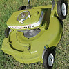 """A Lawn Boy 21"""" mower, built in 1963, featured a 2-cycle 4-horsepower engine with finger-tip start. The 50-year-old mower, recently restored by David Nicholson, is used to cut the grass in the back lot of Garfield Furniture. (Staff Photo by BONNIE VCULEK)"""