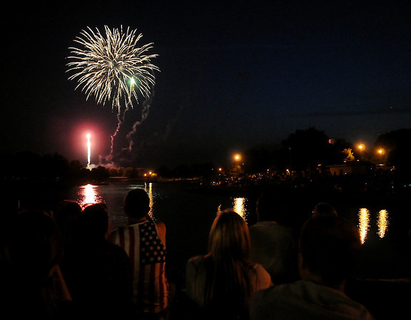 Thousands line the banks around Meadowlake Park as they listen to the Enid Symphony Orchestra and watch the Fourth of July fireworks Thursday, July 4, 2013. (Staff Photo by BONNIE VCULEK)