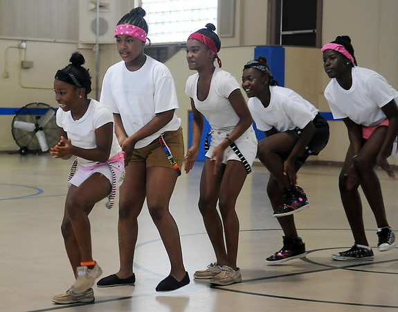 Booker T. Washington Community Center summer camp participants and volunteers perform a group dance during the annual camp show Friday, July 26, 2013. (Staff Photo by BONNIE VCULEK)
