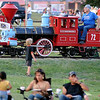 The Enid Kiwanis engineer blows the whistle on the Meadowlake Flyer at Meadowlake Park as families arrive for the Fourth of July fireworks extravaganza Thursday, July 4, 2013. The train was filled with riders until the annual fireworks show began. (Staff Photo by BONNIE VCULEK)