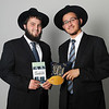 Jewish Emissaries Levi Misholovin (left), from West Bloomfield, Michigan, and Moshe Sasonkin, from Akron, Ohio, are visiting in Enid. Misholovin and Sasonkin are holding Teffilin, Jewish Prayer Boxes, and Kippah, Jewish head covering. (Staff Photo by BONNIE VCULEK)