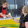 Shelbi Fore serves Summer Fletcher a banana snow cone at E-Town Ice Tuesday, July 9, 2013. (Staff Photo by BONNIE VCULEK)