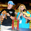 Gwen Hunt, from Lawton, holds her Grand Champion dachshund Mocha as she pauses for a portrait with Chad Preble, from Norman, and his reserve grand champion dachshund, Charlie, during the 4th annual Paws 4 the Cause 2013 Dachshund Dash at the Chisholm Trail Coliseum Saturday, July 27, 2013. Proceeds from the event fund the purchase of Enid Police Department police dogs. (Staff Photo by BONNIE VCULEK)