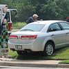 Earl Mabry, M.D. checks on the driver of a Lincoln MKS after a two-vehicle crash at the corner of Willow and Cleveland near Willow Plaza Monday, July 1, 2013. (Staff Photo by BONNIE VCULEK)