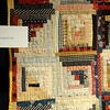 Log Cabin quilt made in 1890 and used by Isaac M. Smith during the Run. The quilt was given to the Cherokee Strip Regional Heritage Center by Maude Alice Burlington. (Staff Photo by BONNIE VCULEK)