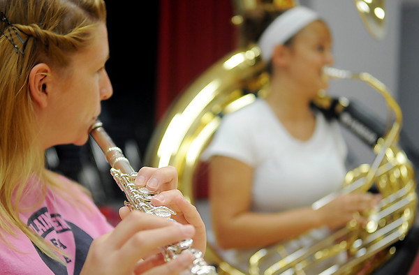 Brianna Chesson (left) plays flute as she and Megan Levendoski provide music during a color guard practice during the Chisholm High School band camp Wednesday, July 24, 2013. (Staff Photo by BONNIE VCULEK)