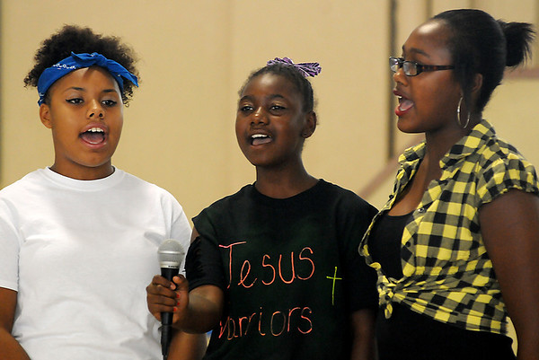 Angelic Voices, Le vashae, Destiny, and Johnetta, perform the National Anthem during the Booker T. Washington Community Center summer camp show Friday, July 26, 2013. (Staff Photo by BONNIE VCULEK)