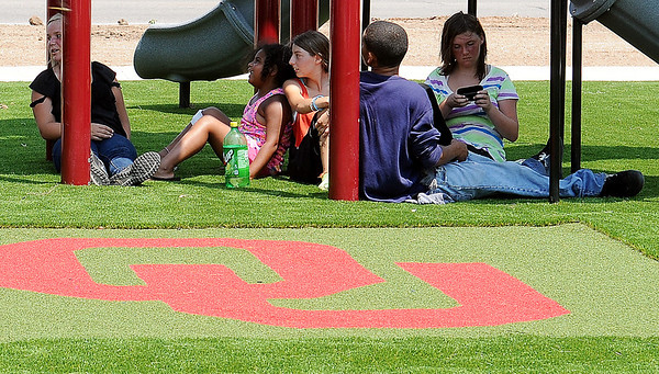 Children relax on the artificial turf at Champion Park Friday, July 5, 2013. The grand opening of the new City of Enid park, at 10th and Chestnut, will be Sunday at 11 a.m. (Staff Photo by BONNIE VCULEK)