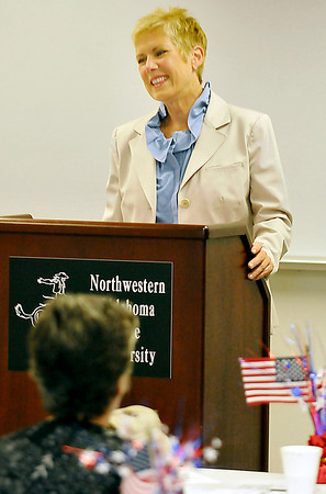 Oklahoma state school superintendent, Janet Barresi, speaks to foster grandparent volunteers Wednesday at NWOSU-Enid. (Staff Photo by BILLY HEFTON)