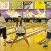 Sandy Tate, Rylee Hack and Deborah Ruthenberg concentrate as they move to the music during the National Dance Day video-taping event at Oakwood Bowl Saturday, July 27, 2013. (Staff Photo by BONNIE VCULEK)