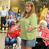 Kelly Ronistal, from Enid, smiles after her name was drawn for the $1,000 check from Communication Federal Credit Union during the One Grand Summer Give Away at Oakwood Mall Saturday, July 27, 2013. (Staff Photo by BONNIE VCULEK)